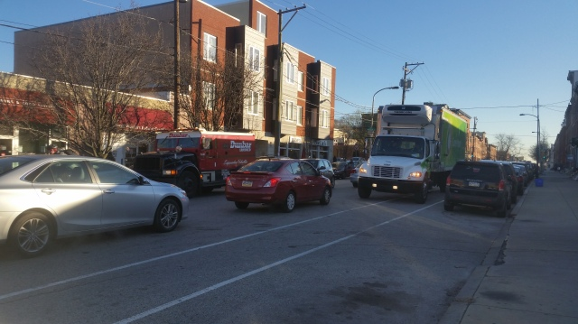 Both bike lanes blocked (and traffic lanes fouled) by trucks facing west, 1900 block of Fairmount Ave.